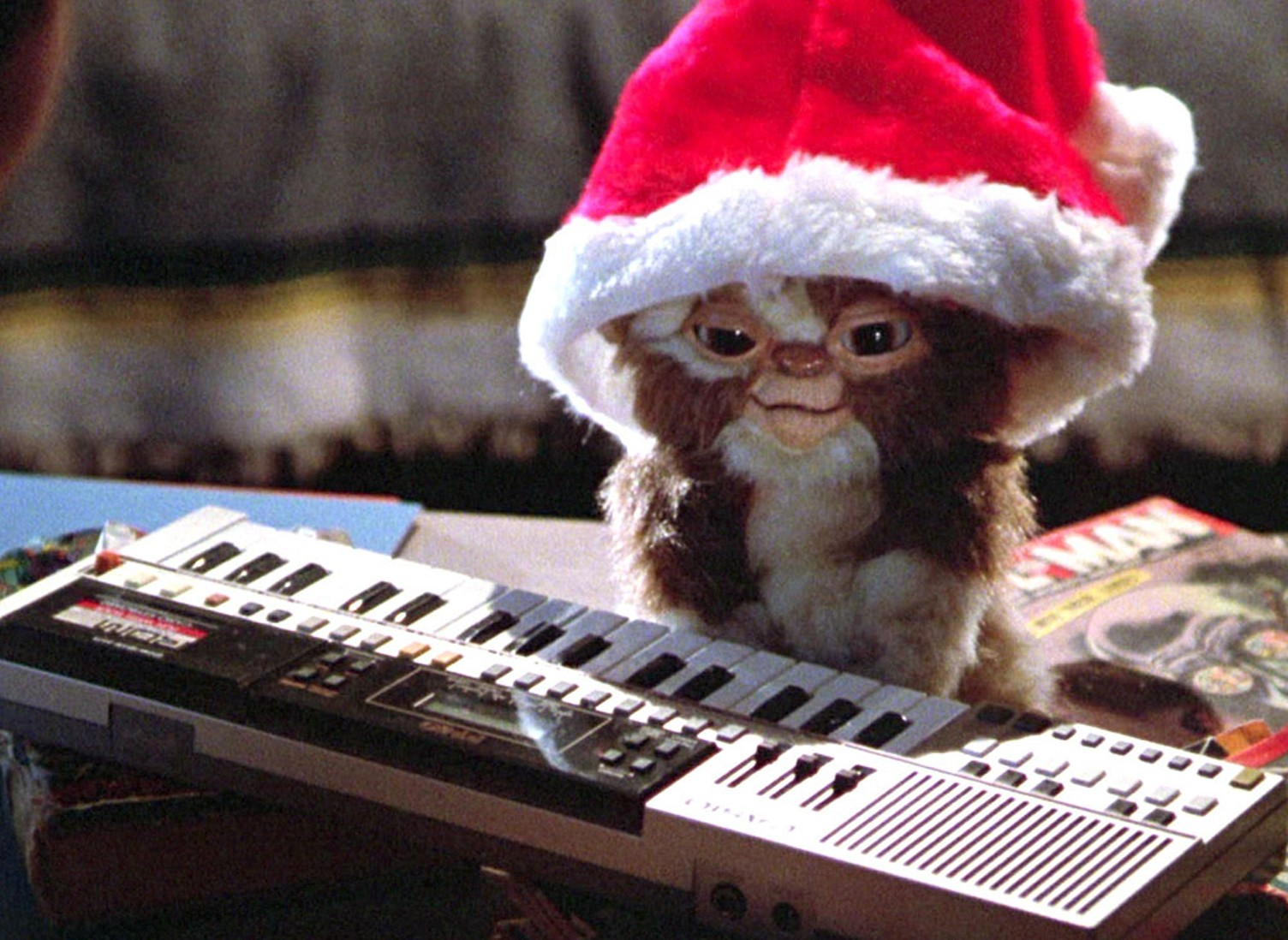A gremlin wears a Santa hat and plays the keyboard in this non-traditional Christmas movie.