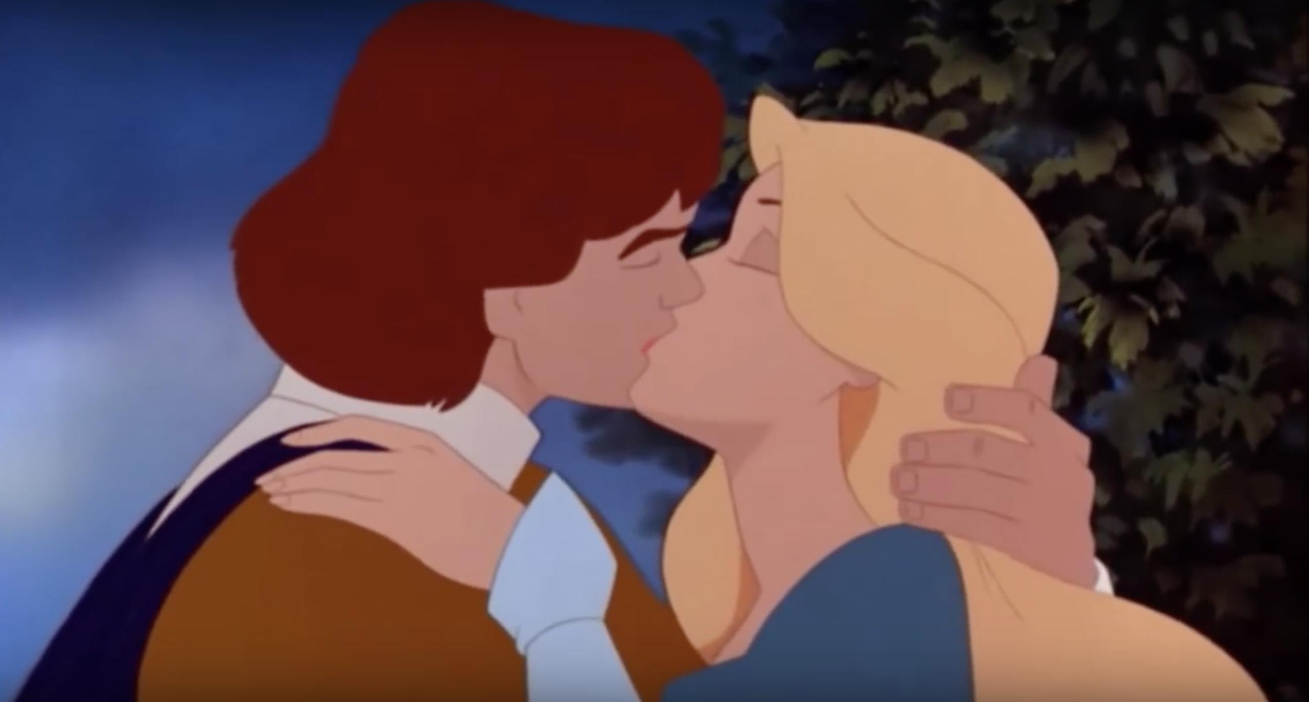 Derek and Odette sharing true love's kiss.