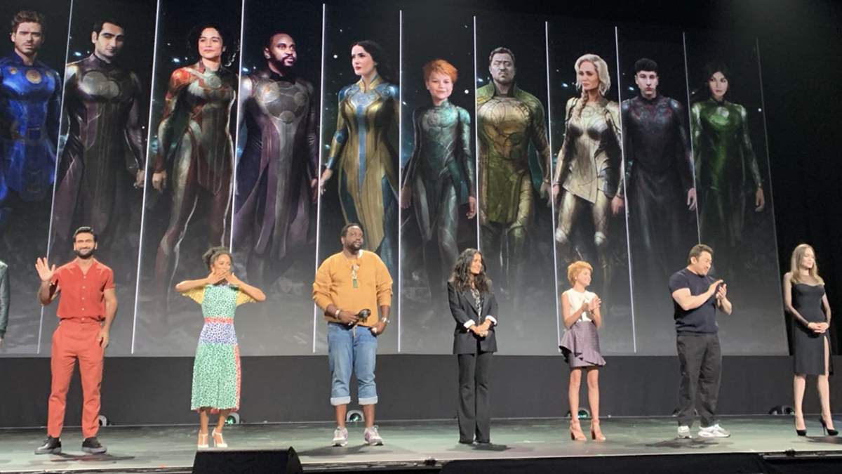 Marvel Phase 4: Eternals: The cast of Eternals pose next to concept art of their costumes at San Diego Comic Con 2019.