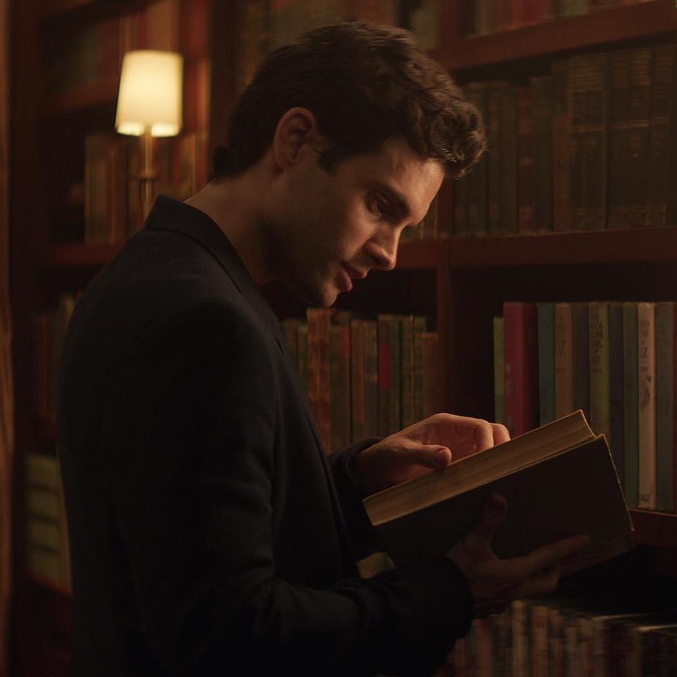 Joe is reading a book seductively.