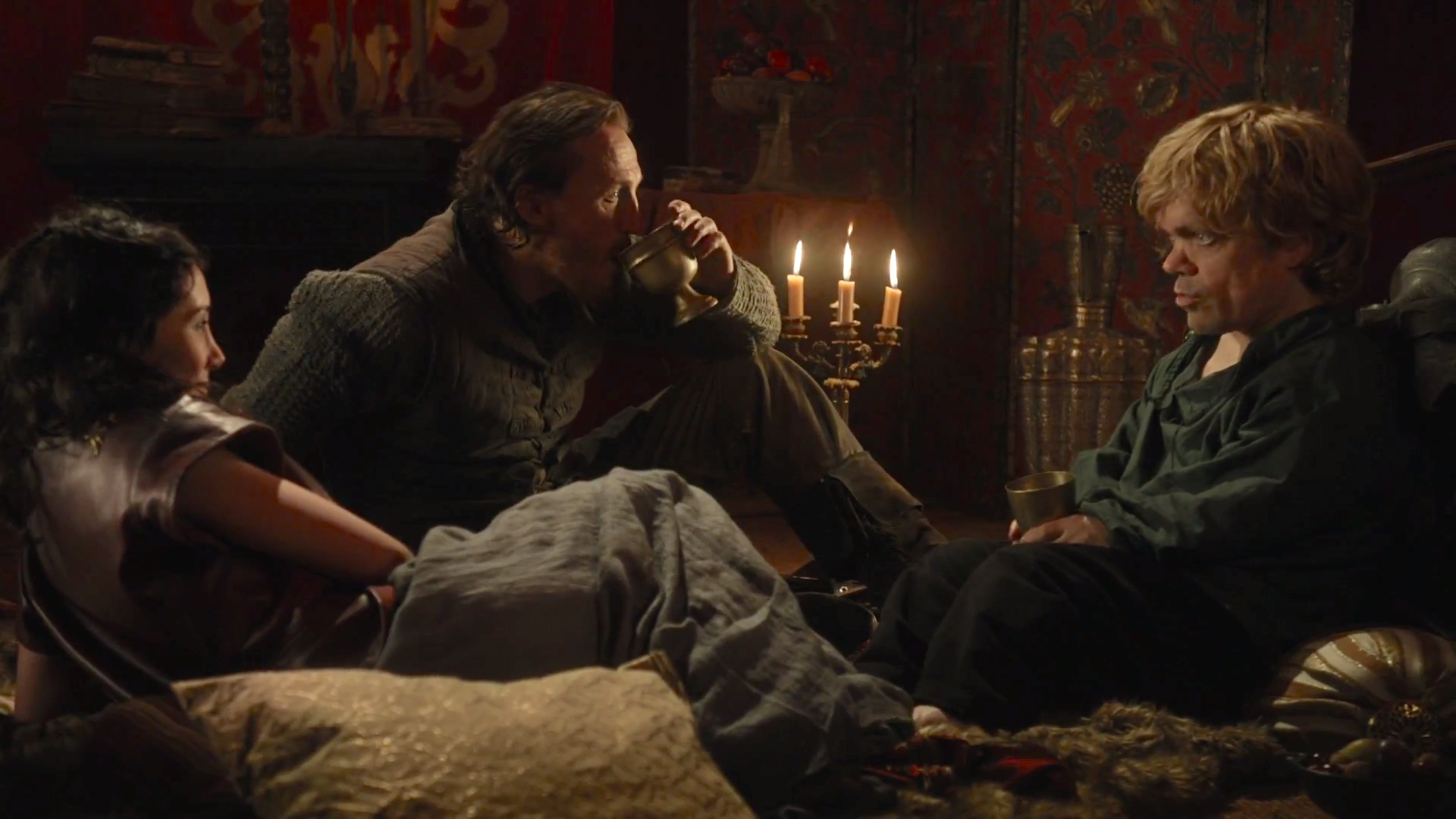 Tyrion, Bronn, and Shae playing Tyrion's drinking game.