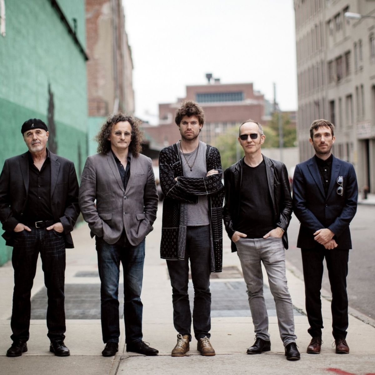 The members of the gloaming standing in a line, outside.