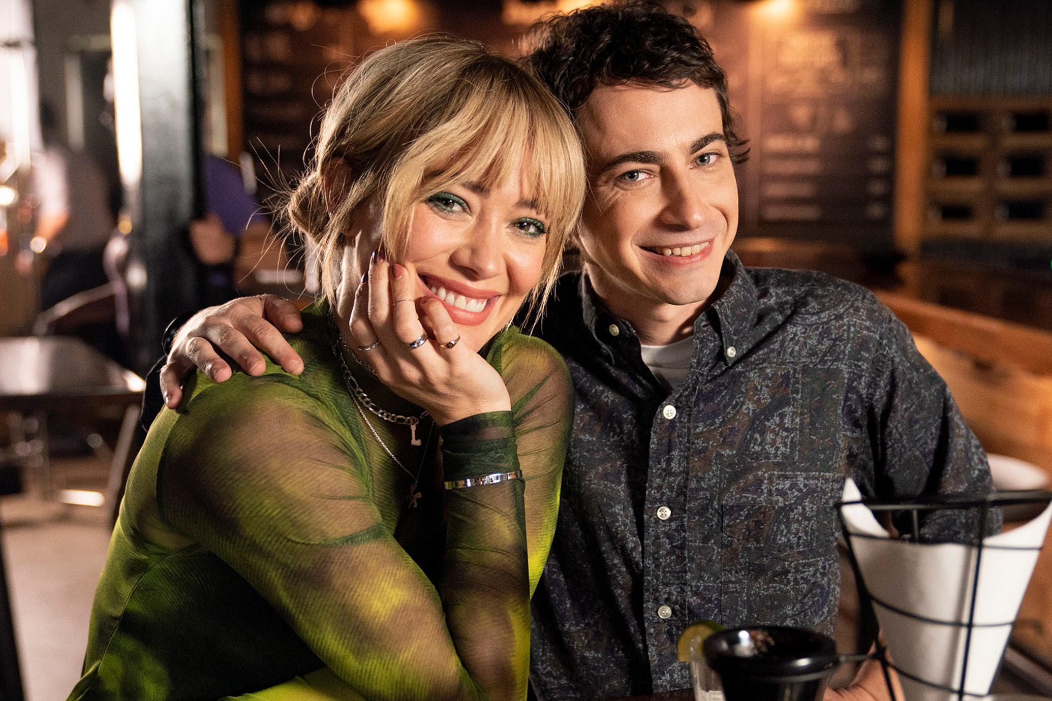 Hilary Duff and Adam Lamberg on set for binge-worthy Lizzie McGuire revival.