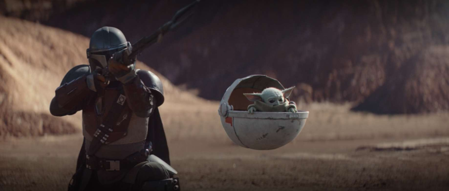 The Mandalorian is poised to shoot his weapon with baby Yoda next time him in a floating pram.
