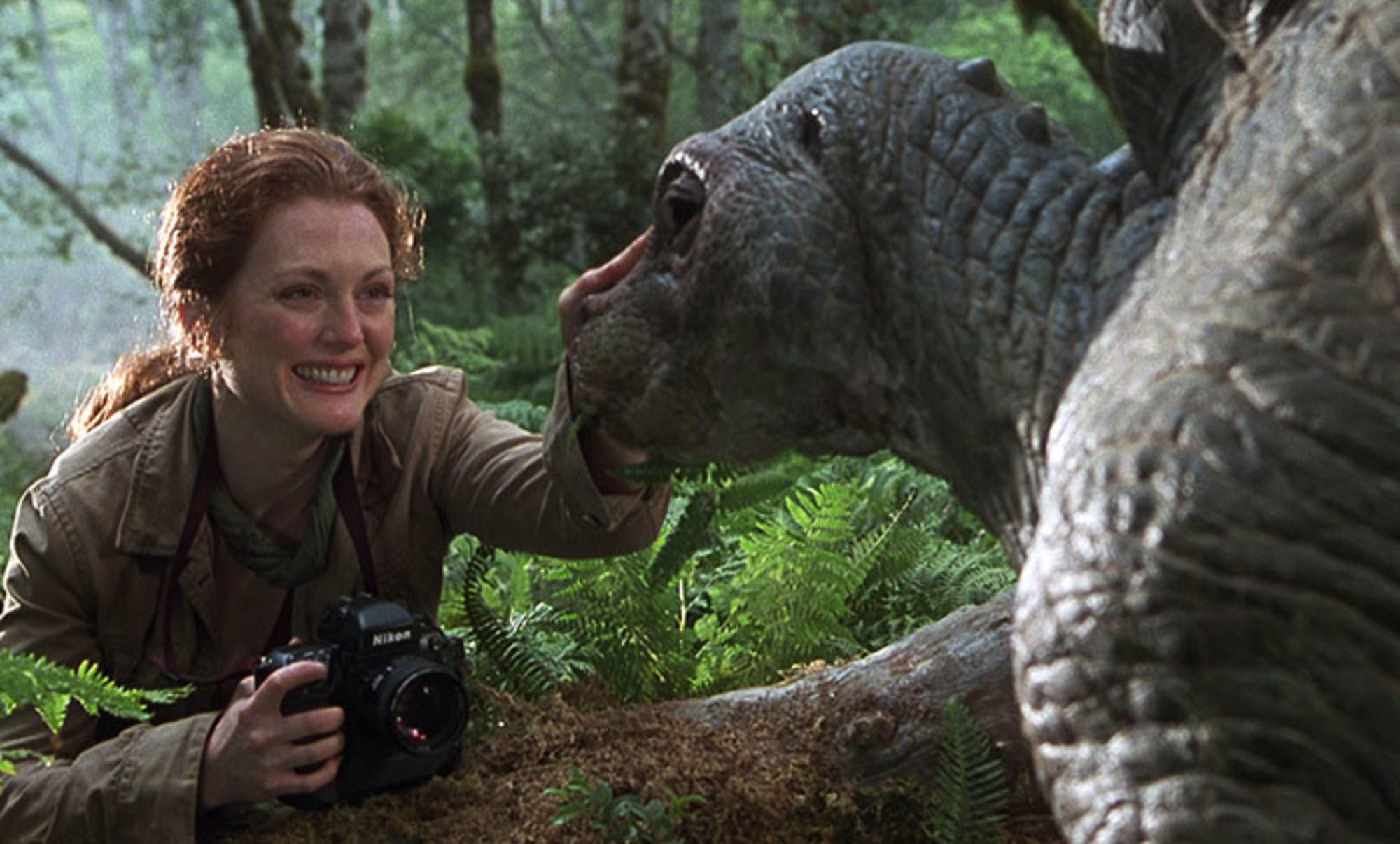 Dr. Sarah Harding from The Lost World: Jurassic Park petting a baby dinosaur