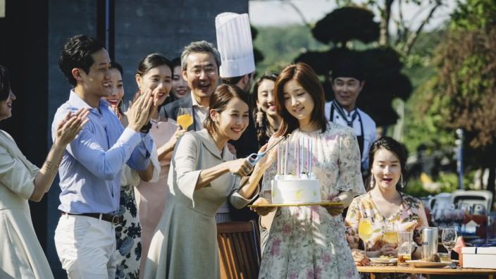 Park So-dam carries a birthday cake as Jessica unaware of the serious danger that awaits her.