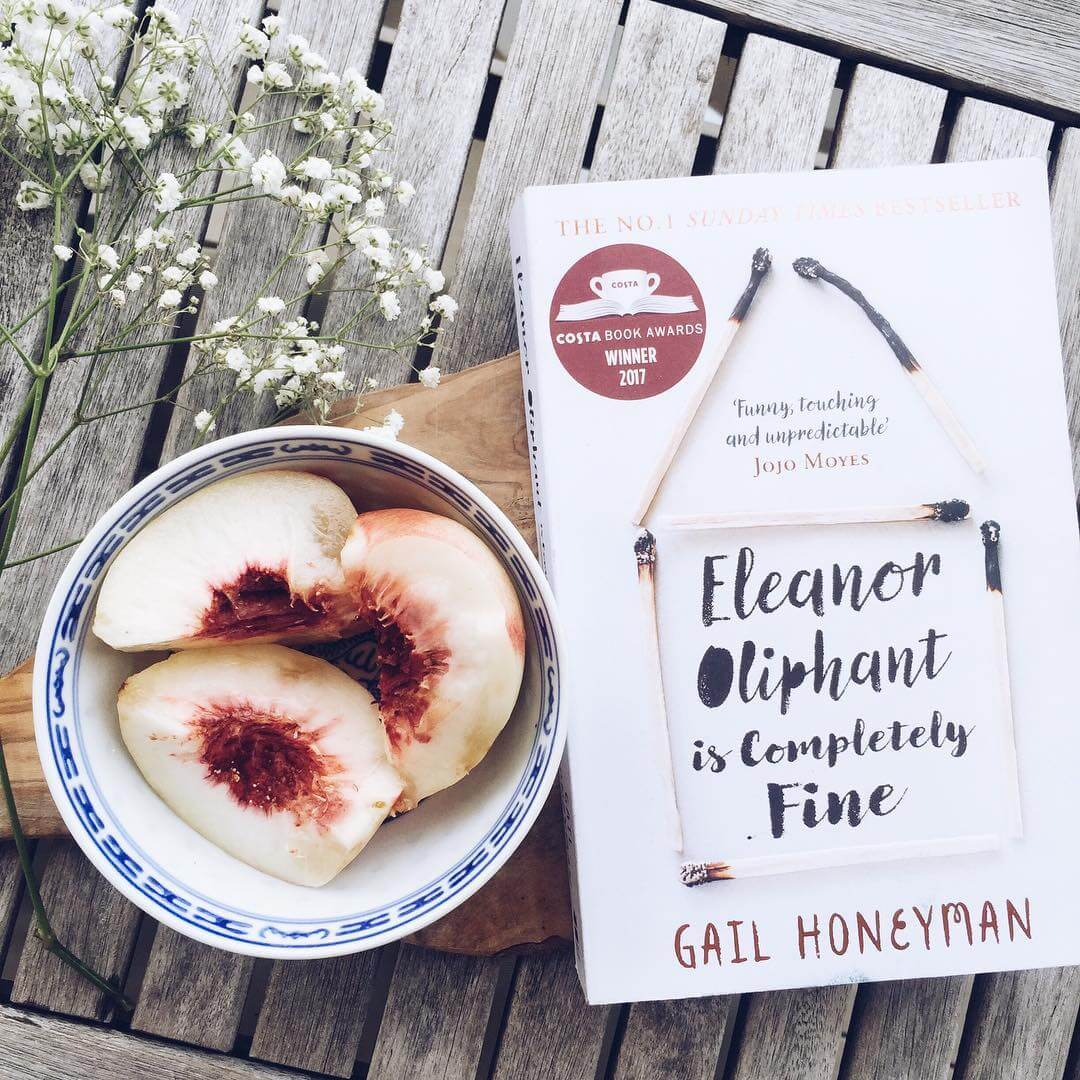 Books: Flat lay of Honeyman's book on a table next to a bowl of figs.