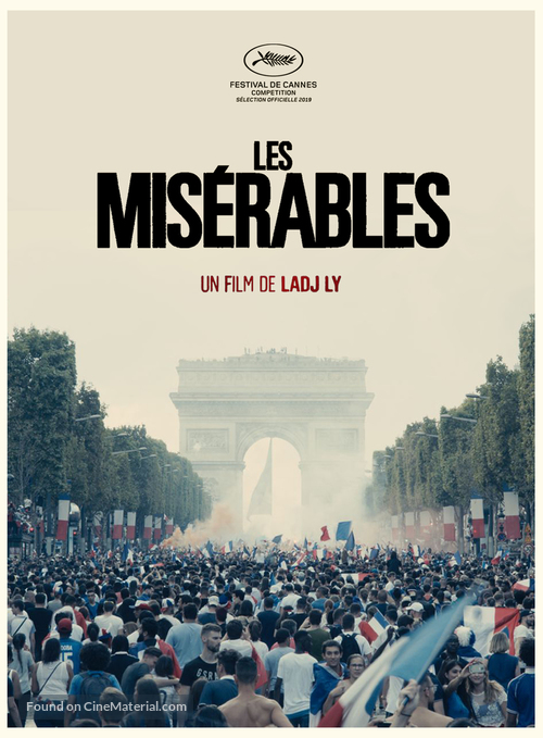 """Directors: A crowd of soccer/football fans celebrates in front of the arc de triomphe with the title """"Les Miserables"""" over top"""