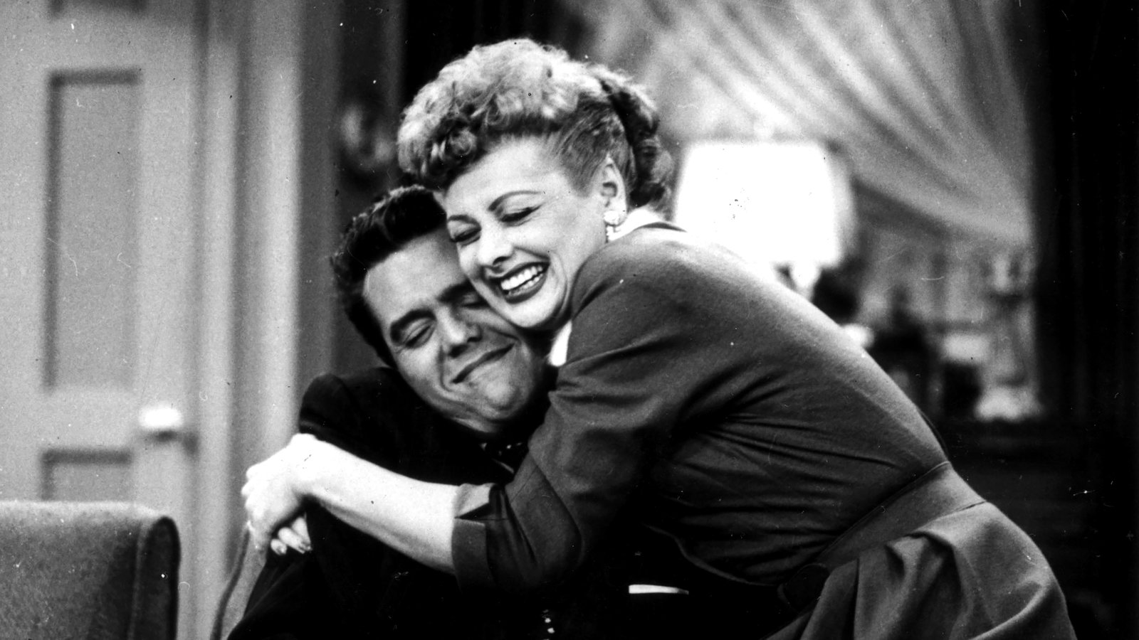 Lucy and Ricky embracing.