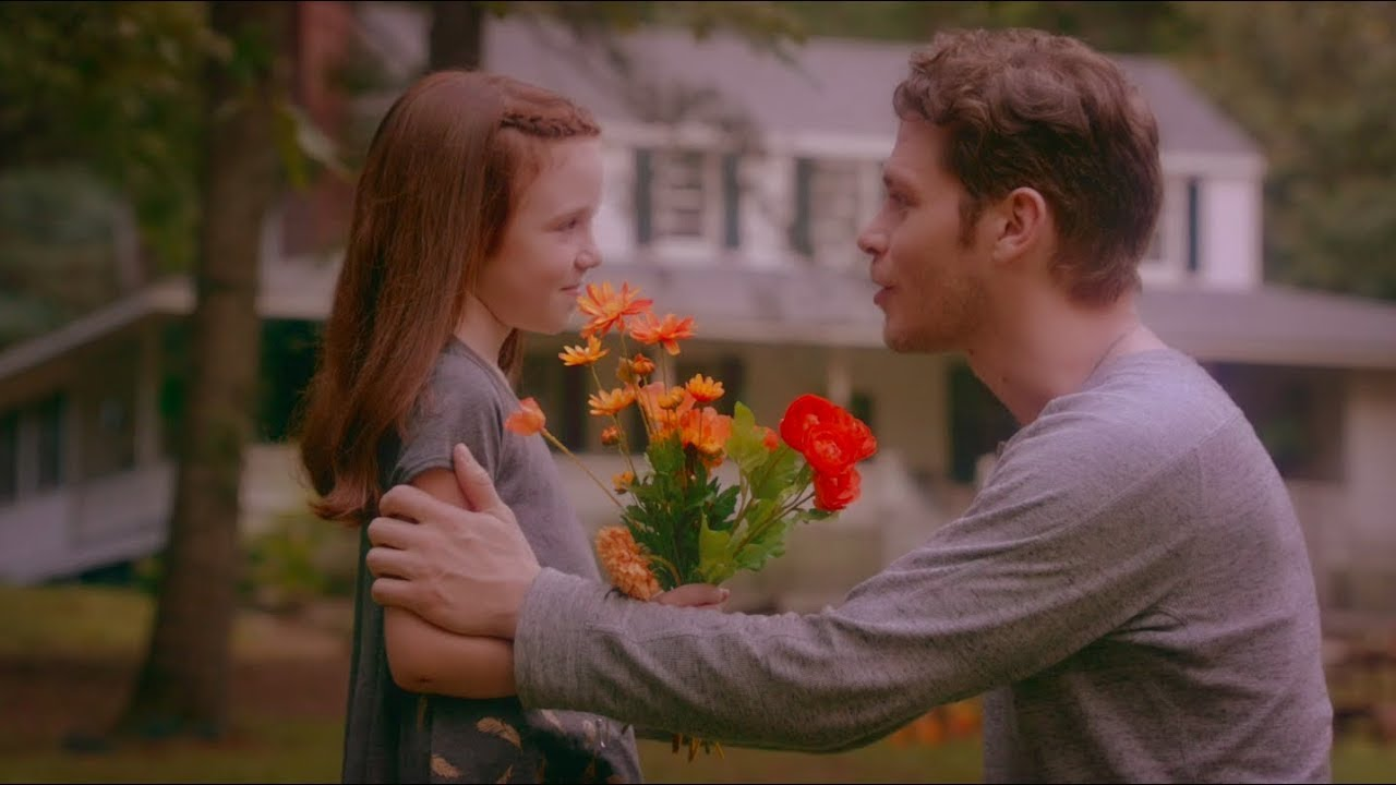 Klaus talking to Hope about finding flowers to make paint.