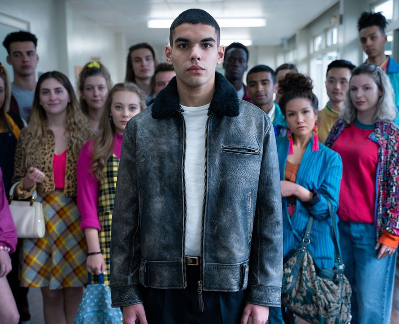 Rahim, the bold new character in Sex Education season two, stands in front of his peers.