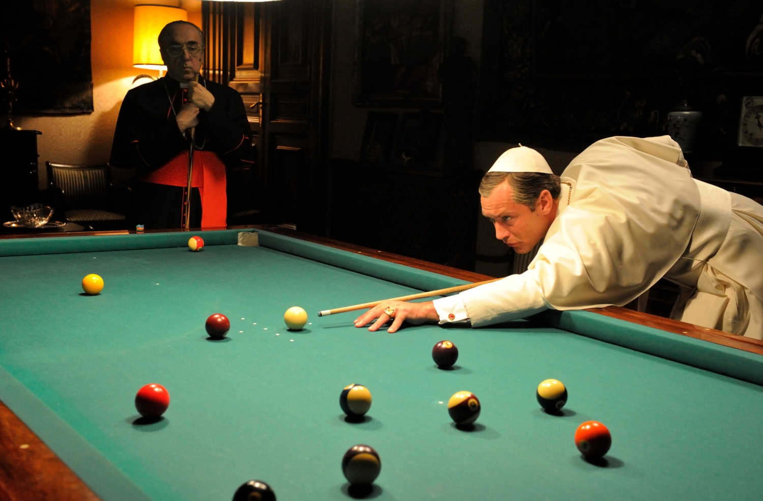 The Prime minister of the Vatican and the young pope having a interesting conversation over a game of pool