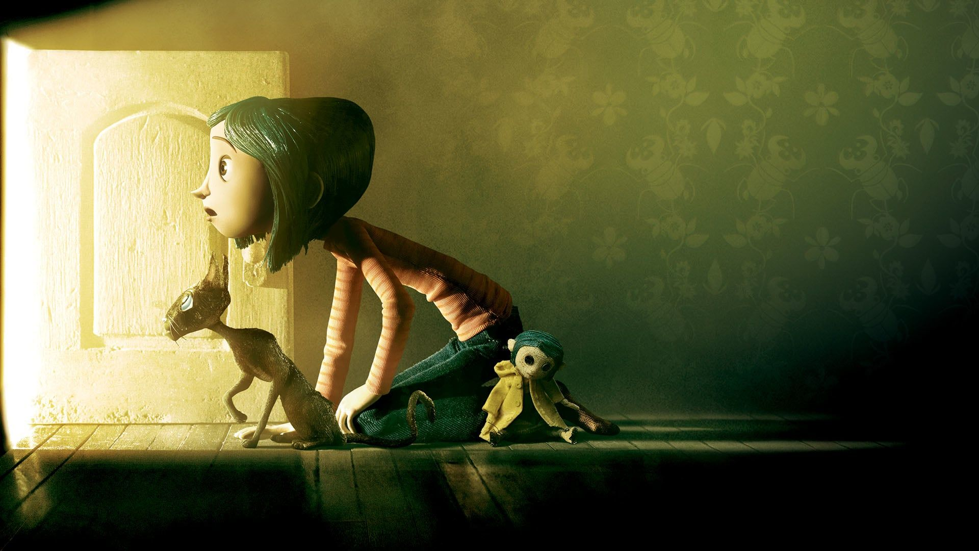 Coraline with her doll and her cat, gazing amazed at what lies beyond the small door.