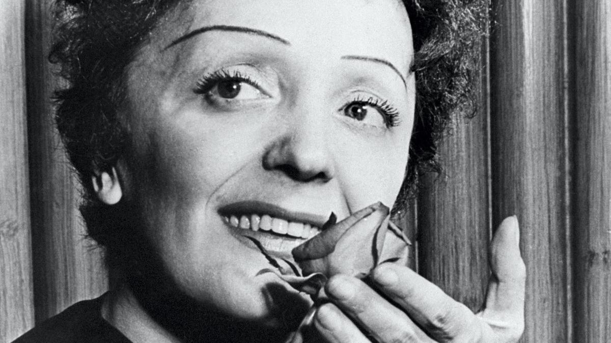 Edith Piaf smelling a beautiful rose lovingly