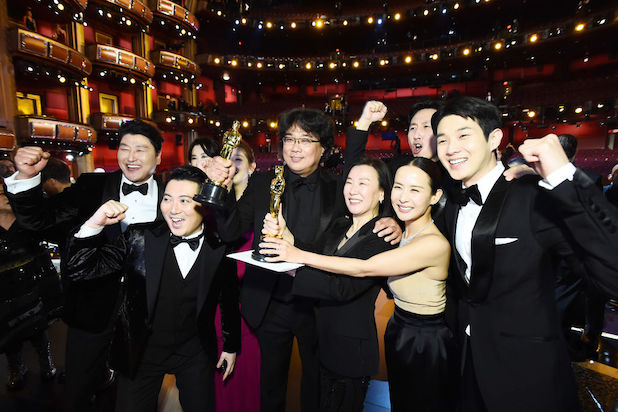 The cast of Parasite pose post-Oscars with their Best Picture Oscar