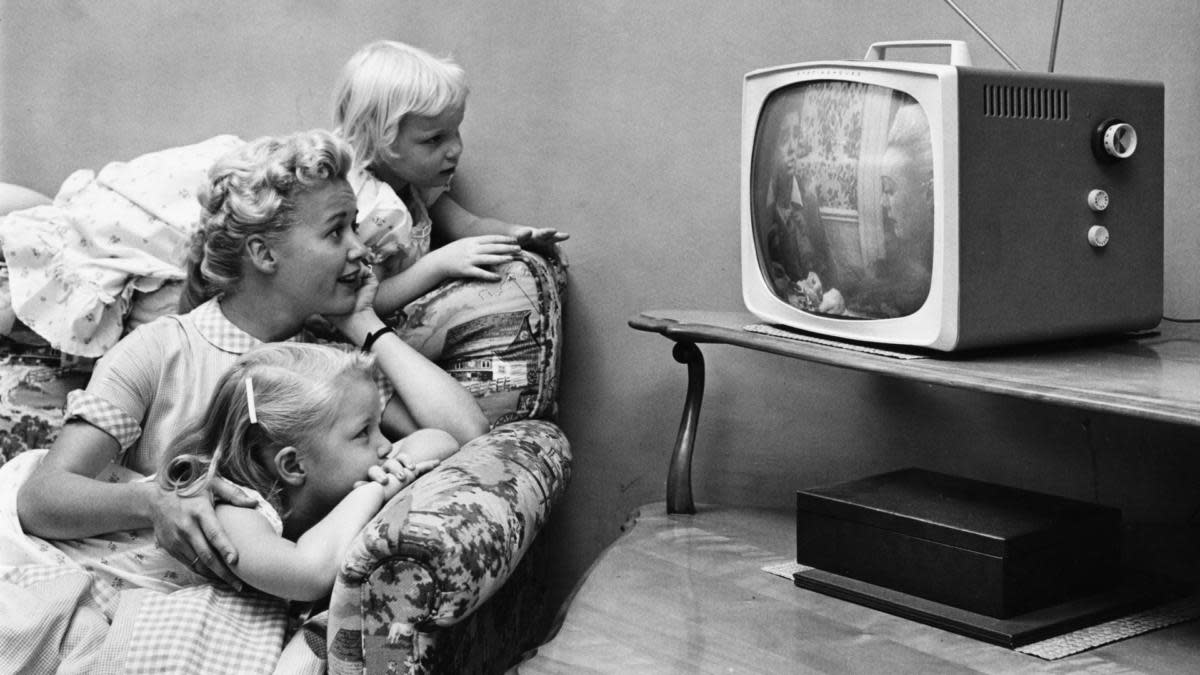 A family watching some of the first TV shows