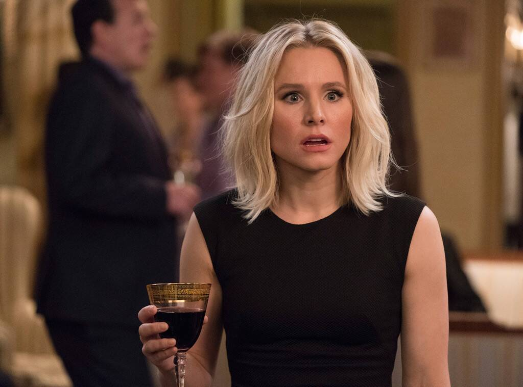 Eleanor from The Good Place holding a glass of wine.