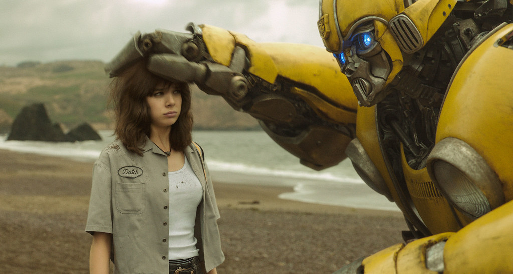 Bumblebee petting Charlie on the head.