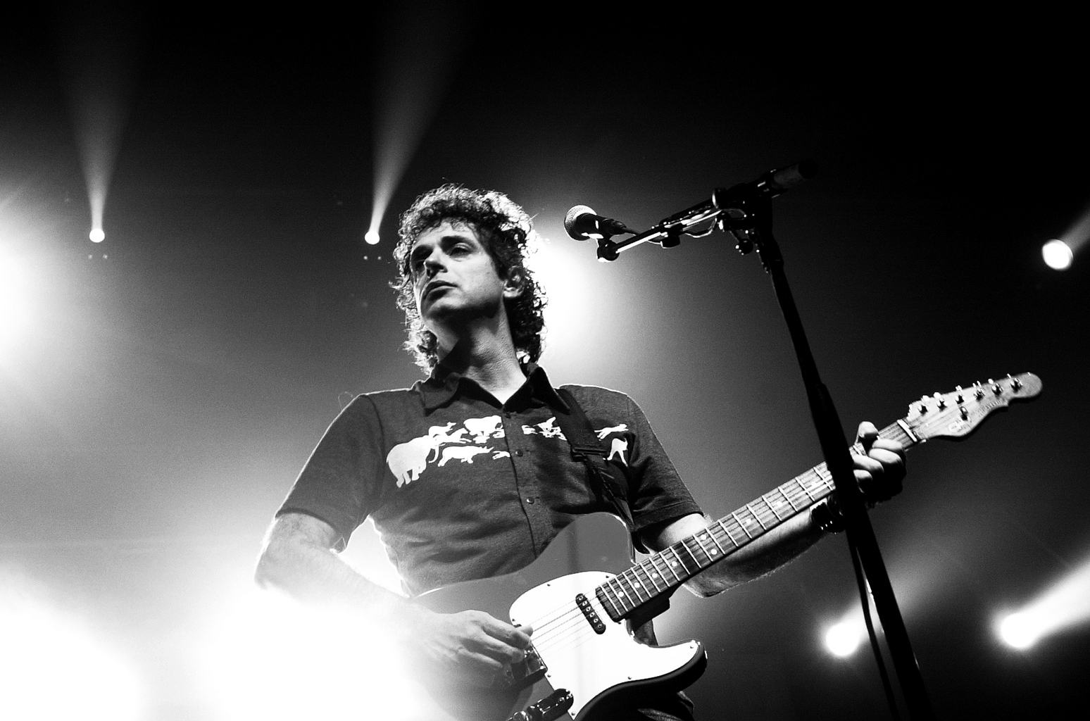 A low angle shot of Cerati playing the electric guitar