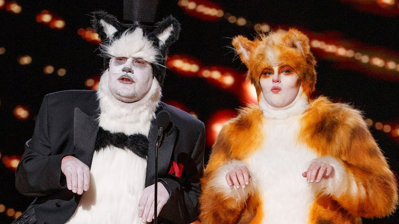Rebel Wilson and James Cordon present the award for Best Visual Effects dressed as Cats.