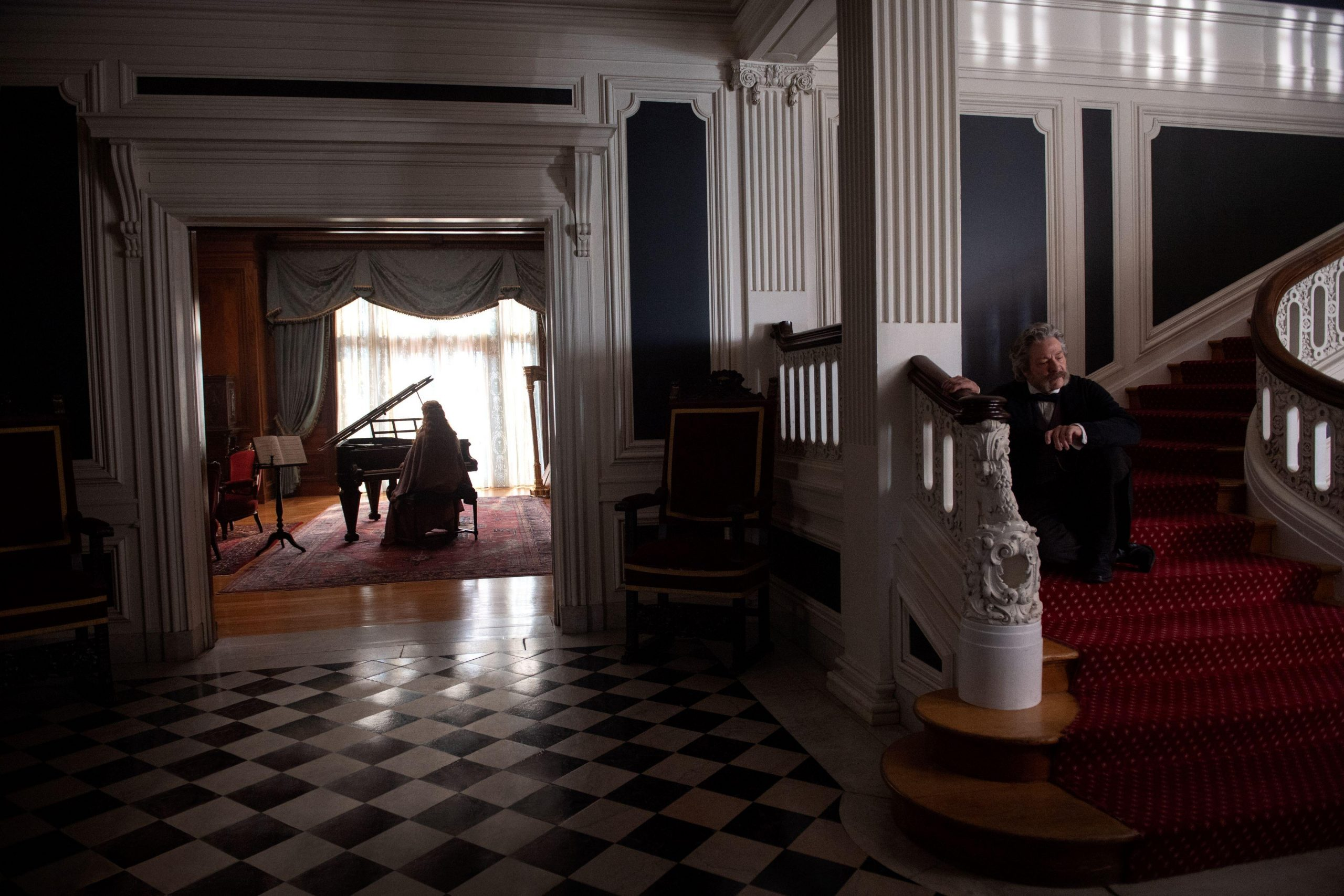 Little Women (2019): Beth plays the grand piano in the Lawrence mansion while Mr. Lawrence listens