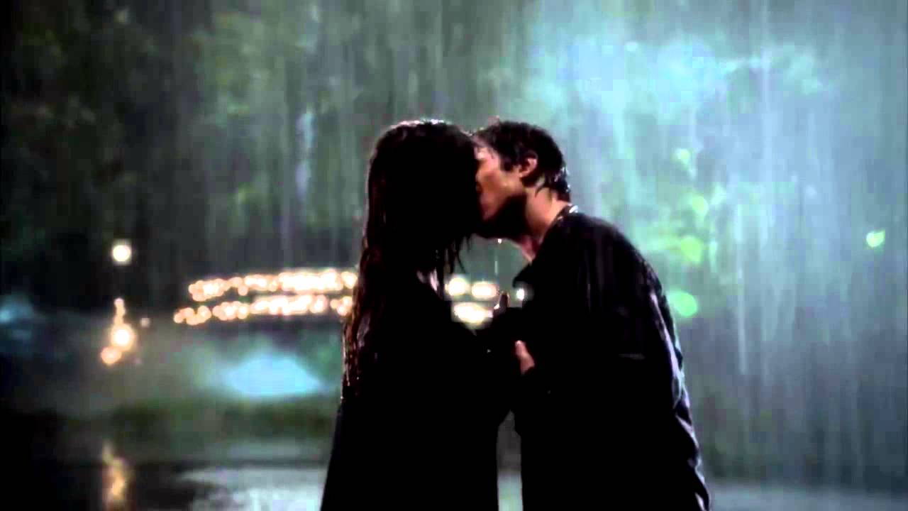 One of the most popular TV relationships, Damon and Elena, kissing in the rain.