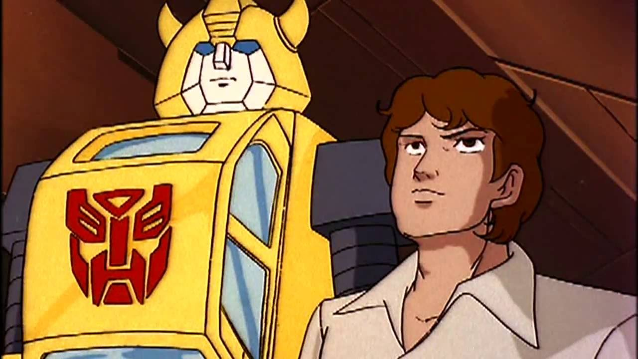 Transformers Gen 1 Bumblebee standing next to Spike.