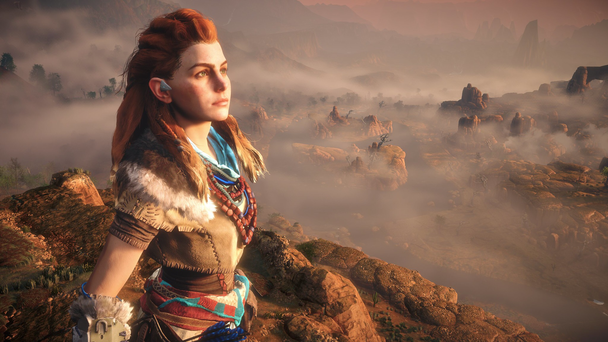 Aloy of Horizon Zero Dawn in the mountains surrounded by mist