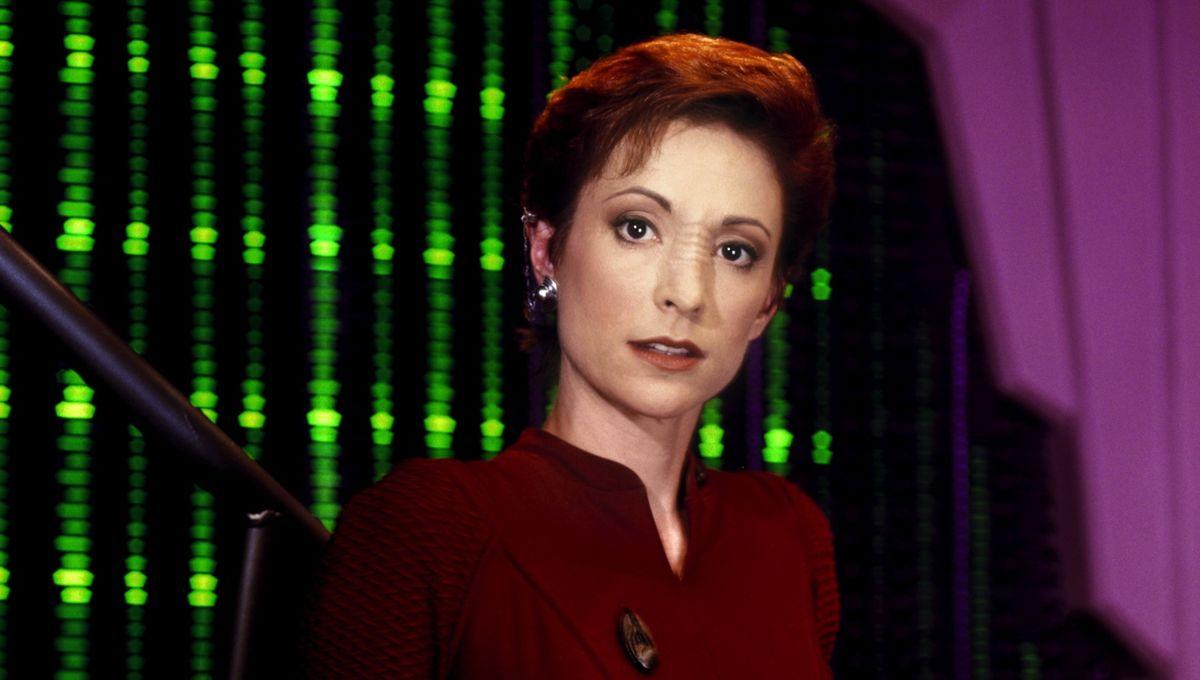 Kira Nerys of Star Trek: Deep Space Nine standing in front of green lights