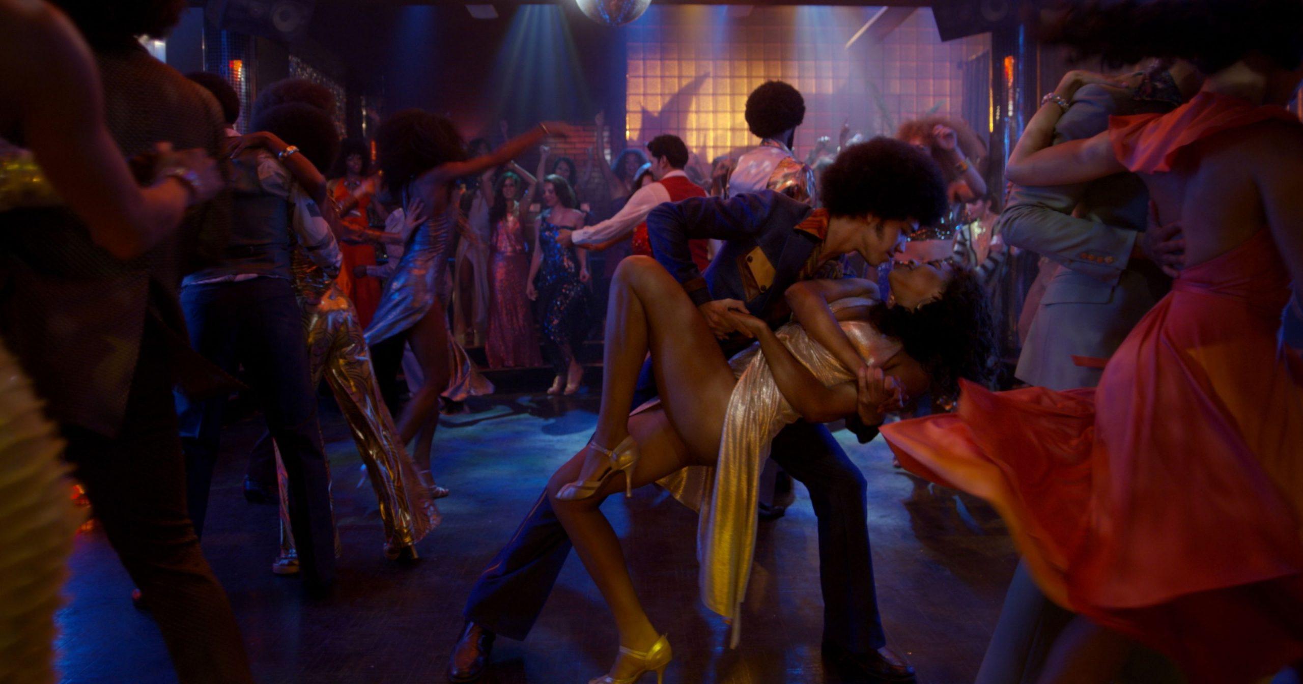 Zeke (Smith) dances with Mylene (Guardiola) at a nightclub.