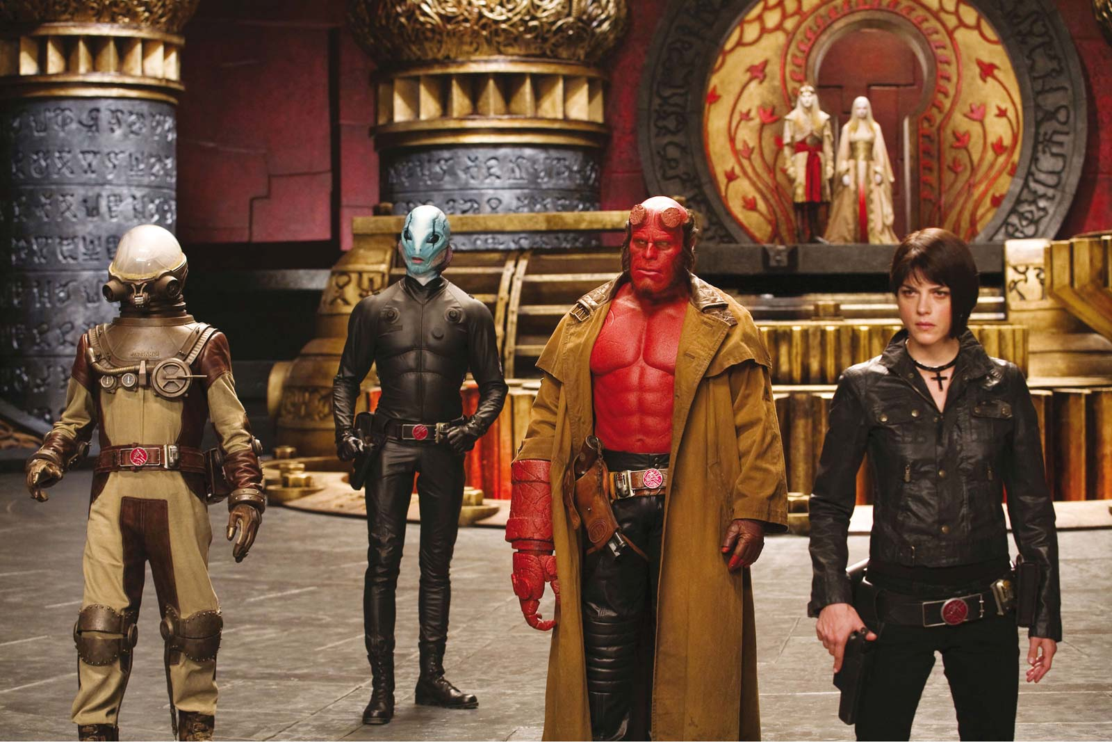 Hellboy stands with his found family.