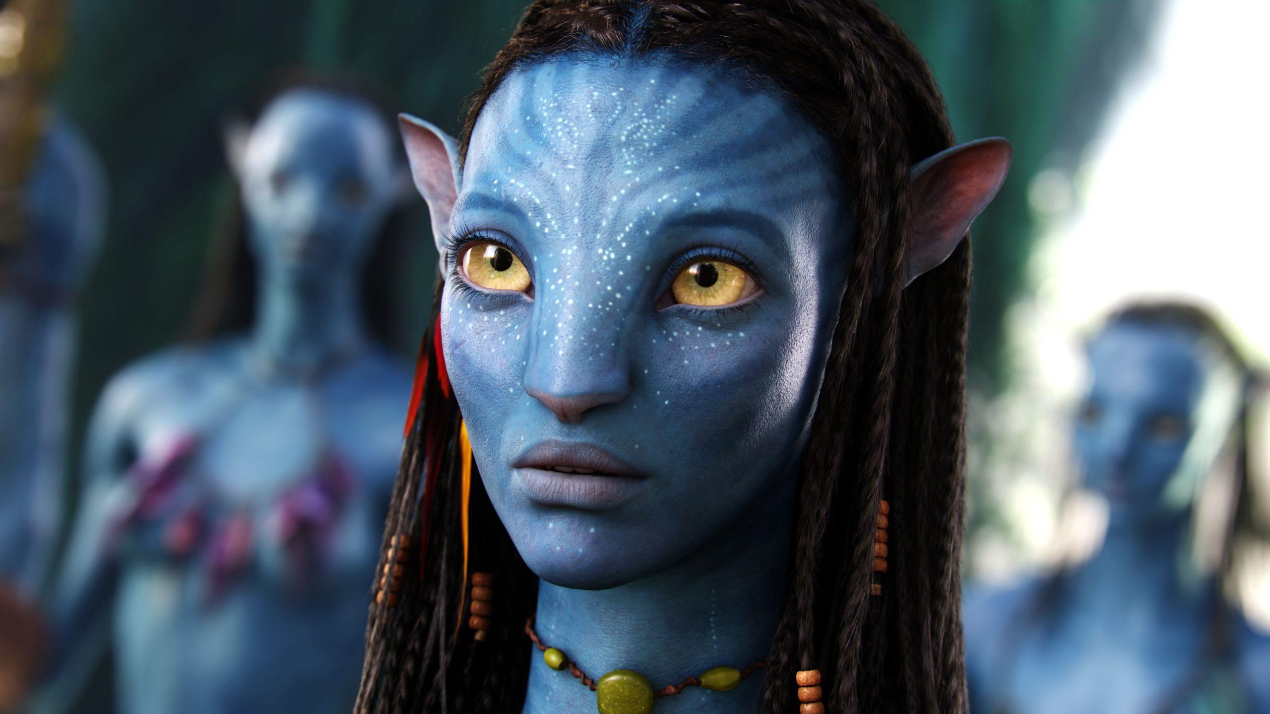 A close-up of Neytiri (Zoe Saldana), a part of a world co-made by James Horner.
