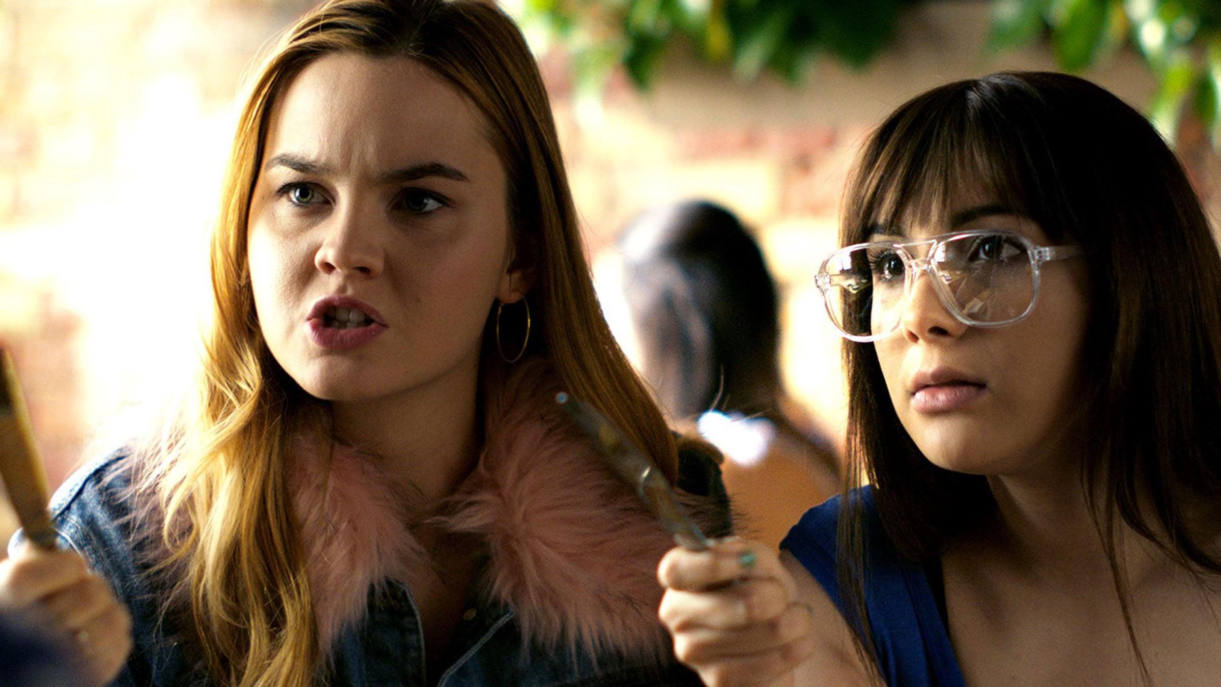 Clara (Liberato) and April (Marks) jokingly threaten their mutual friend Ben
