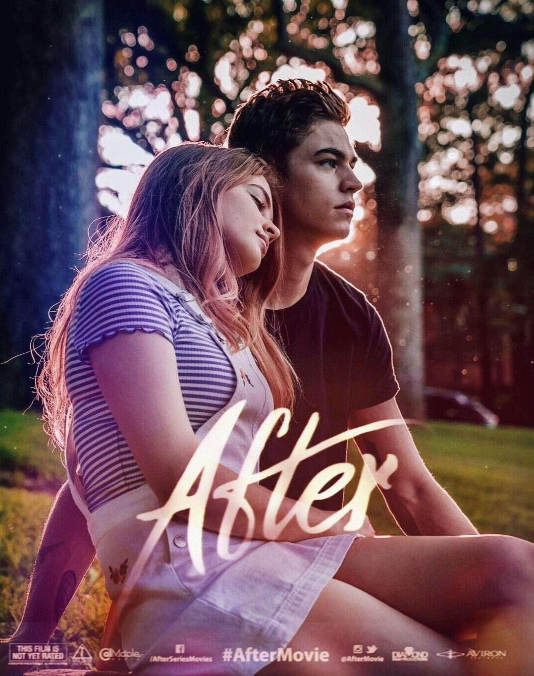 Main characters Hardin and Tessa recline on the grass for the cover of the YA novel movie poster.