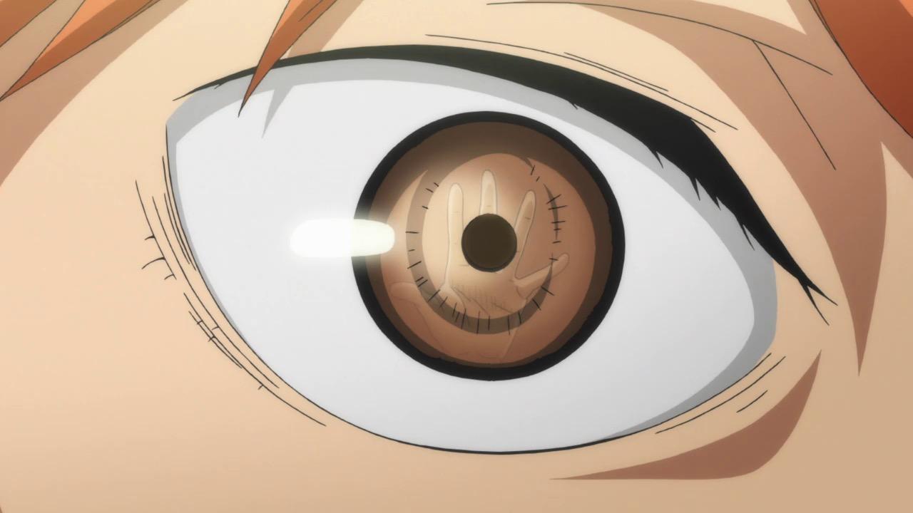 Close-up of Shoyo Hinata's eye reflecting a rival blocker's hand.
