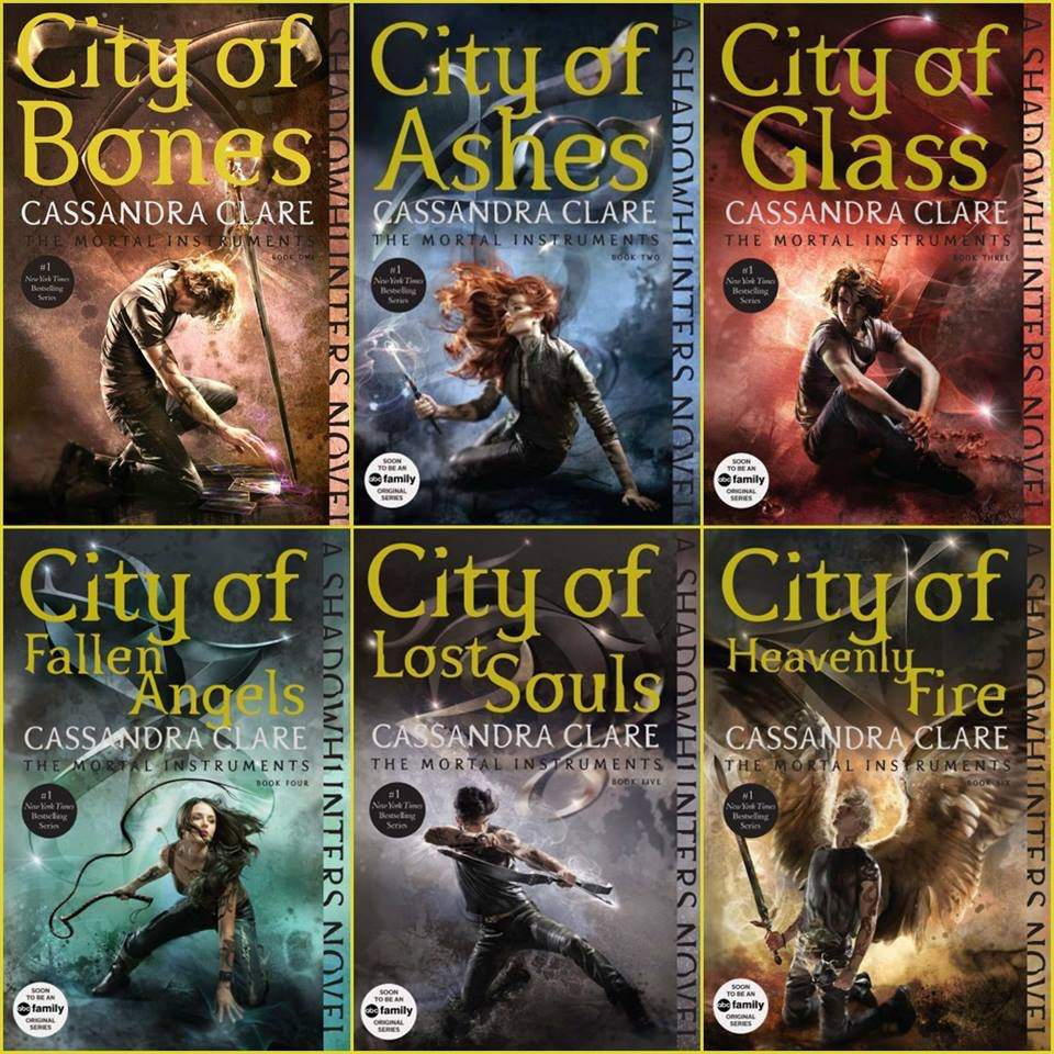 The six stylized covers of the YA novel series The Mortal Instruments. Each has the title along with a main character surrounded by varying colors of light.