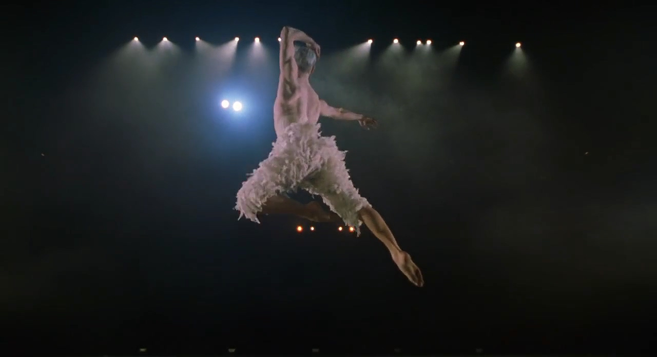 The white swan making his initially leap in the ballet Swan Lake.