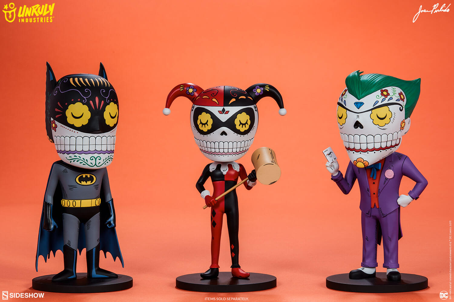 Designer art toys of Batman, Harley Quinn, and The Joker designed to resemble calavera sugar skulls.