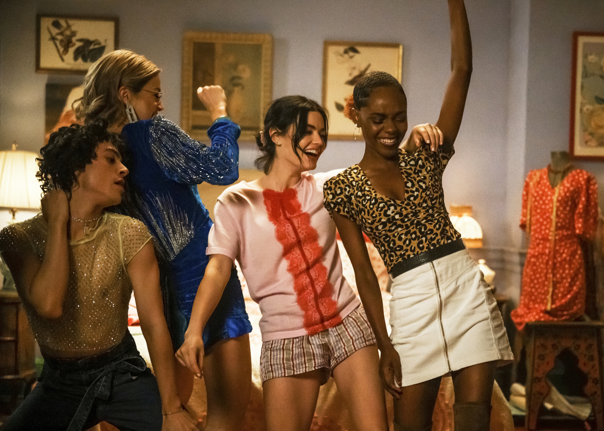 "Katy Keene -- ""Chapter Four: Here Comes the Sun"" -- Image Number: KK104B_1108bc.jpg -- Pictured (L-R): Jonny Beauchamp as Jorge Lopez, Julia Chan as Pepper Smith, Lucy Hale as Katy Keene and Ashleigh Murray as Josie McCoy -- Photo: David Giesbrecht/The CW -- © 2020 The CW Network, LLC. All Rights Reserved."