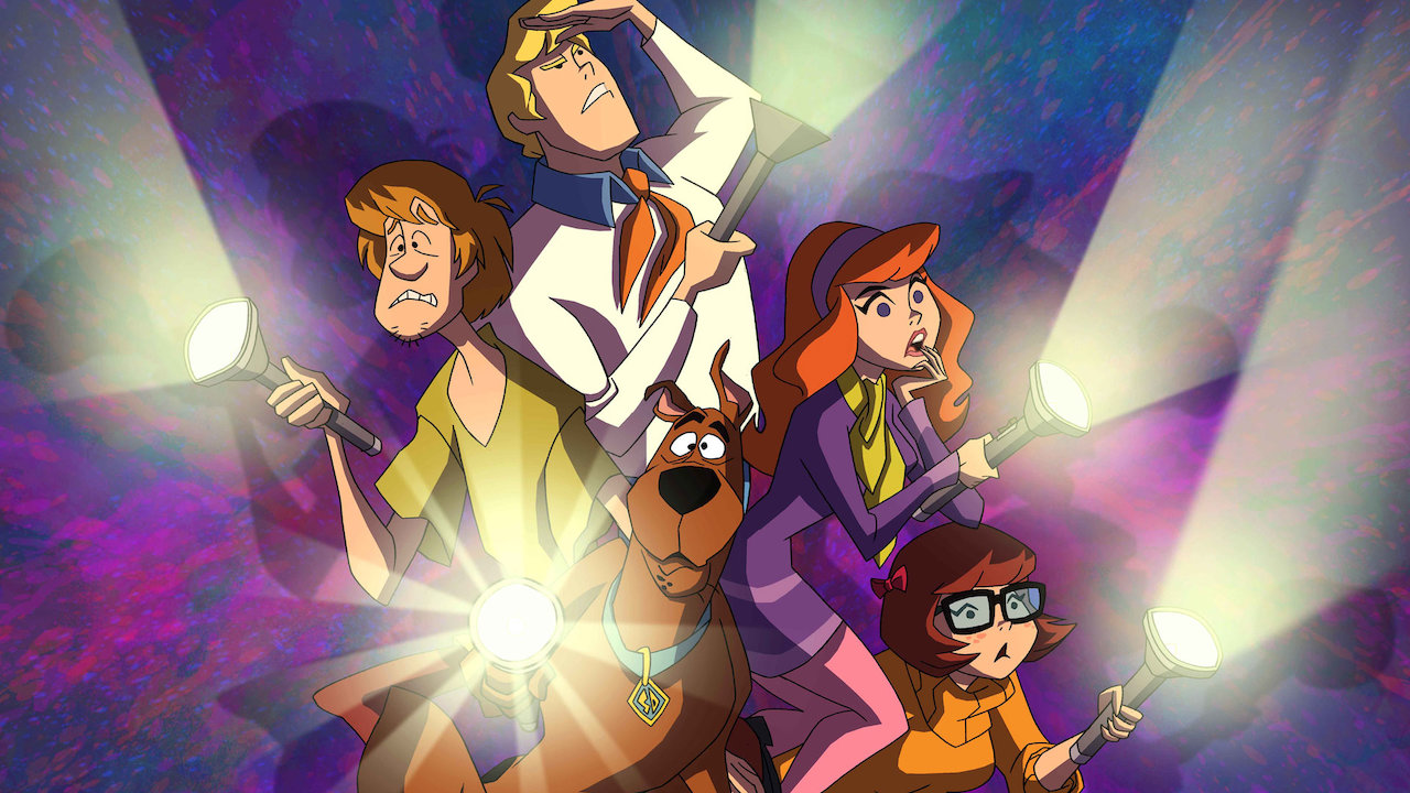"""The """"Scooby gang"""" nervously looks for clues."""