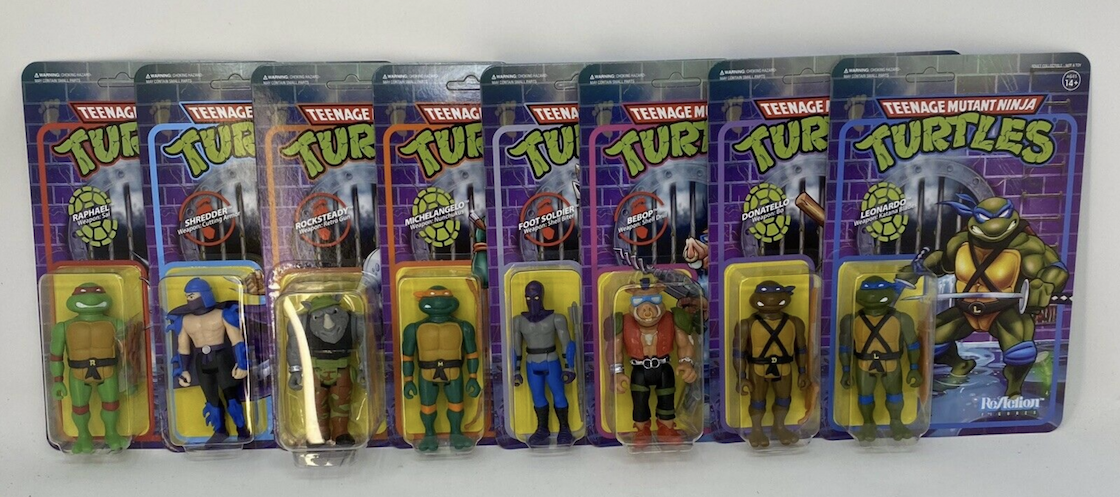 Line up of Teenage Mutant Ninja Turtle art toys made to resemble original action figures.