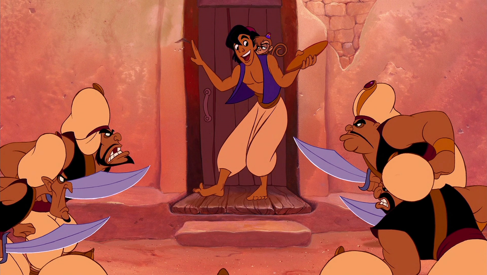 Aladdin holds stolen bread while knives are pointed at him.