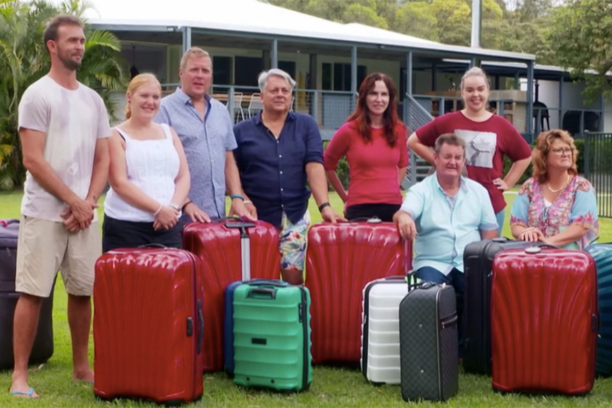 The contestants of travel palate cleanser, Instant Hotel stand outside of their lodgings while being told the rules.