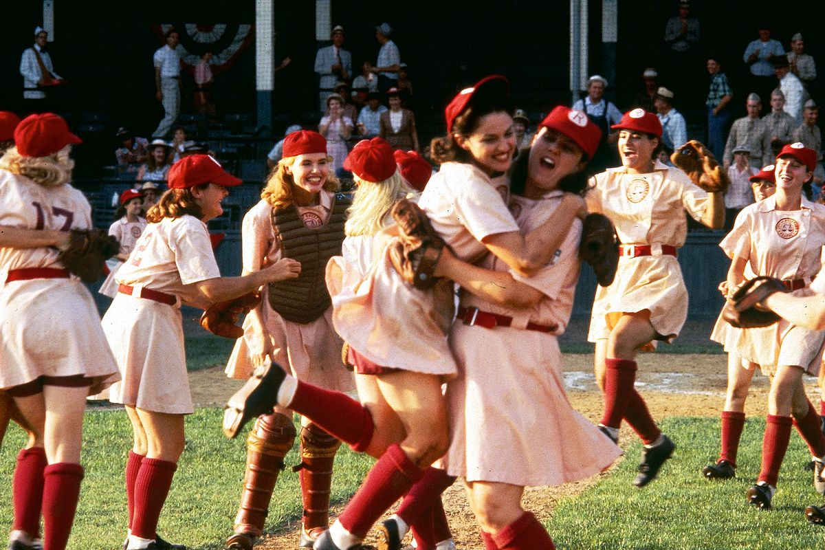 The Rockford Peaches after winning a game, showing excitement to bring up your baseball spirit.