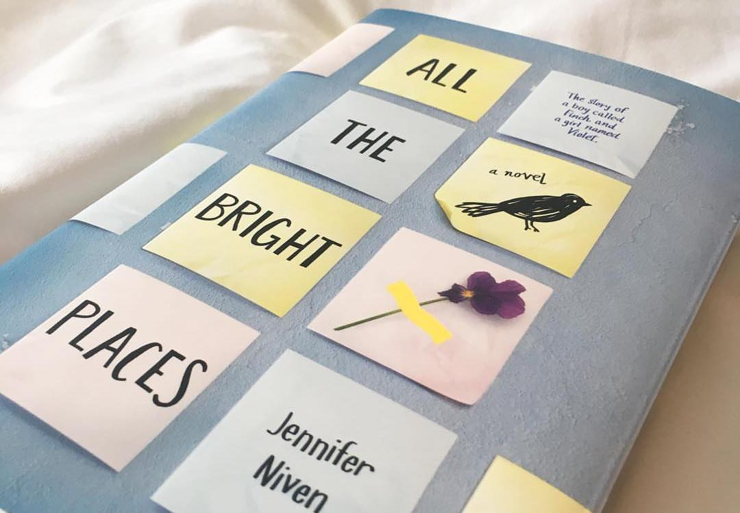 The cover of the YA novel All The Bright Places; light blue with stylized pastel sticky notes depicting the title.