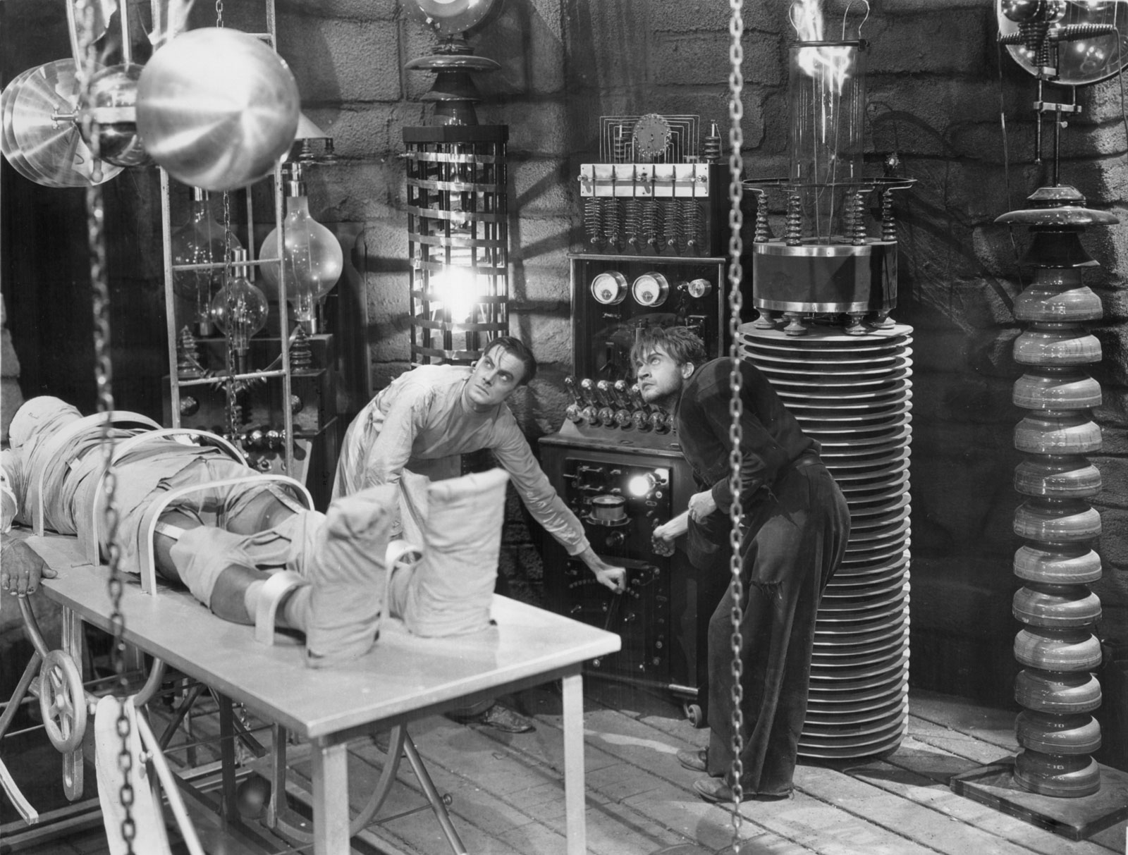 Victor Frankenstein and his assistant attempting to animate a corpse.