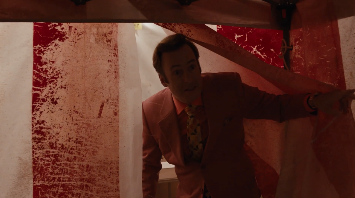 Saul Goodman stands in the opening of a circus tent on Better Call Saul.