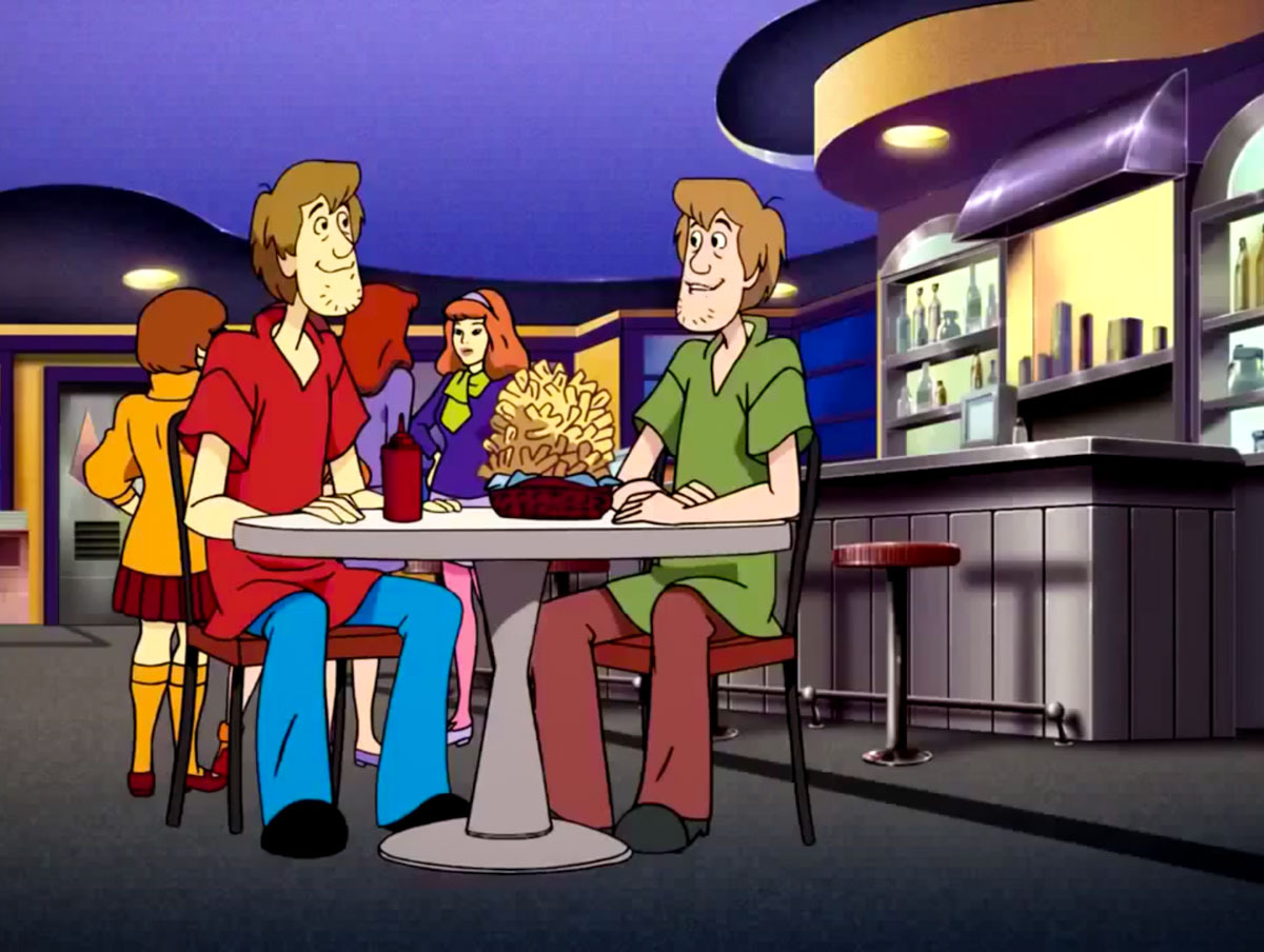 The Scooby-Doo gang chatting with their virtual duplicates.