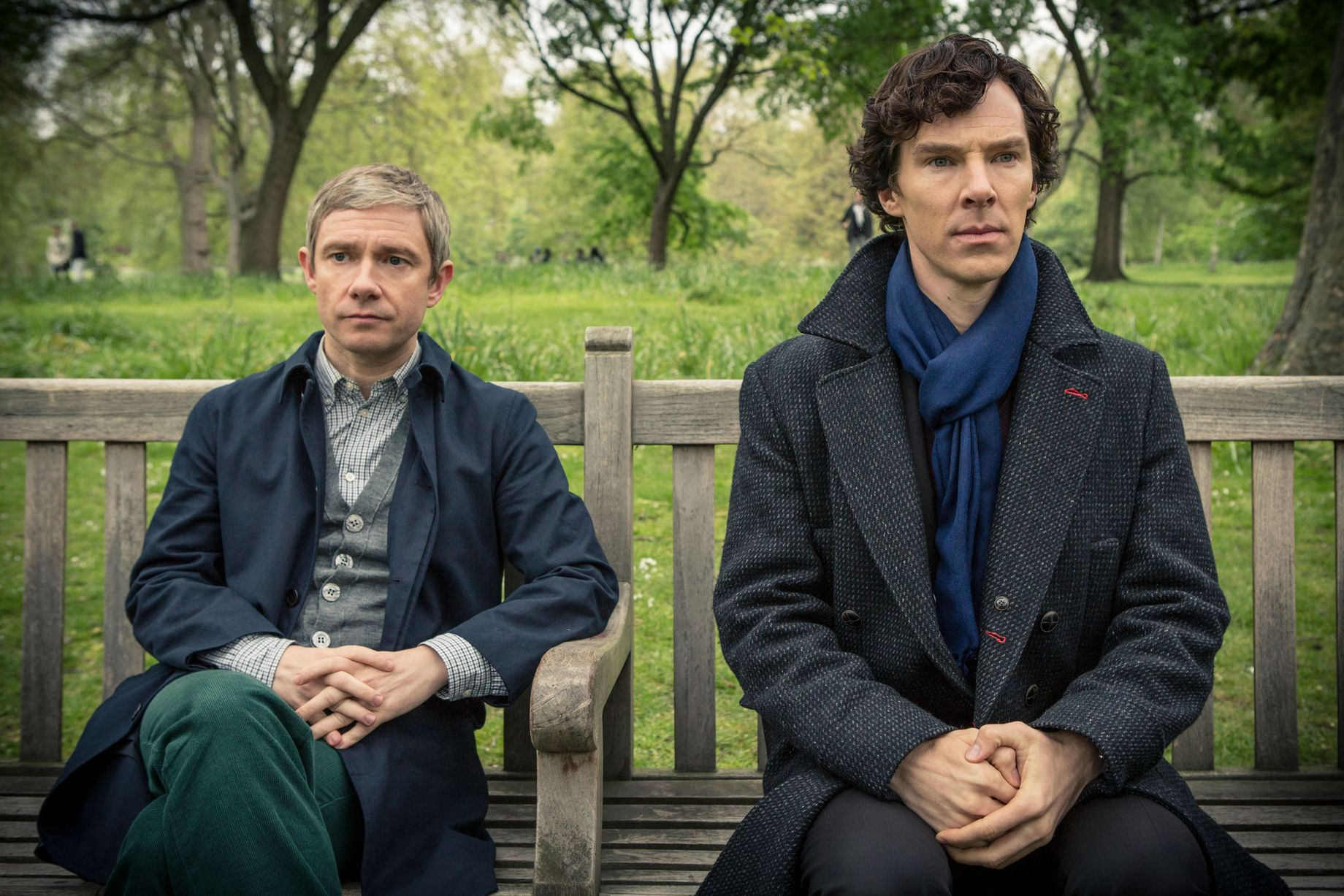 Watson and Sherlock's friendship looks strained as they sit on a bench.