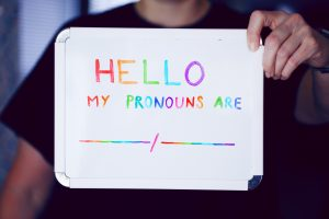 """Sign which reads """"Hello, My pronouns are"""" with a blank space to fill in"""